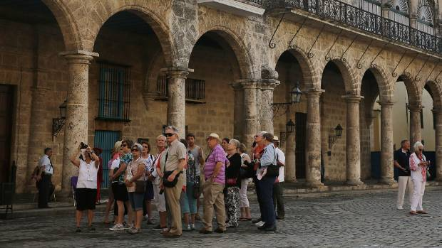 Tourists take in the sites at Cathedral Square in Old Havana.
