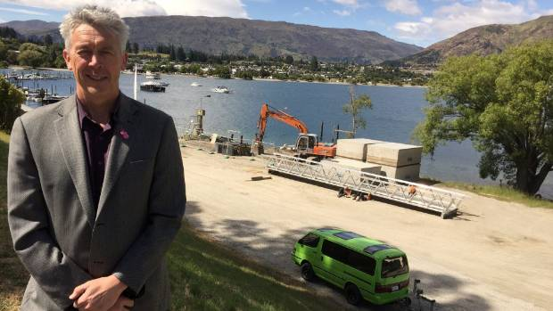 QLDC deputy mayor Calum MacLeod checking on progress at Wanaka's new commercial pontoon.