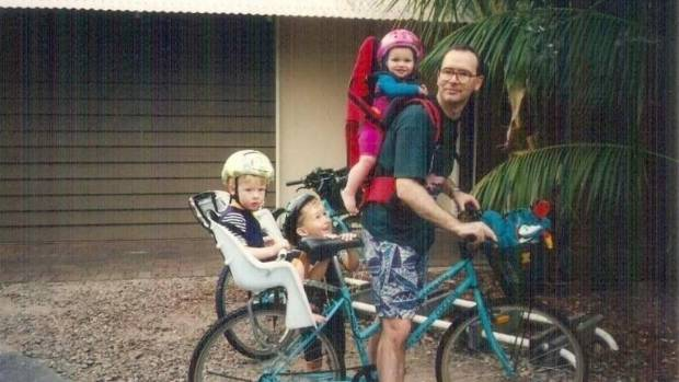 Dr Bryant as a young dad with his children.