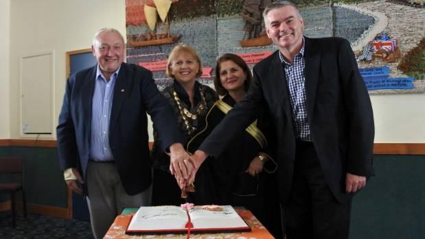 Cutting the cake are, from left: Former TCDC mayor Glenn Leach, mayor Sandra Goudie, Emmi Rezk and Coromandel MP Scott ...
