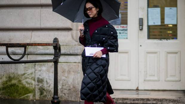 Blogger and street style star Yoyo Cao wearing a black puffer coat outside Stella McCartney at Paris Fashion Week.