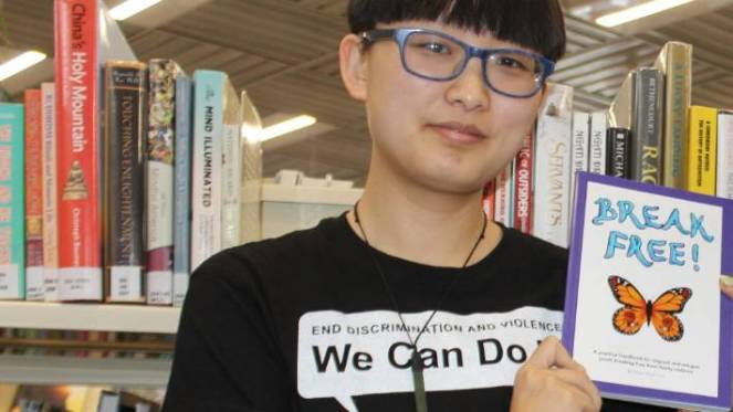 Shakti's national youth co-ordinator Mengzhu Fu with Shakti Youth's handbook, Break Free.