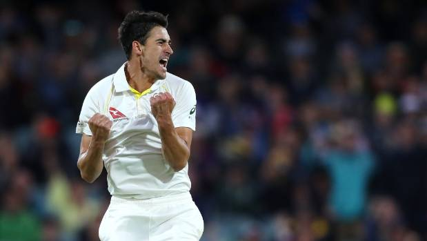 Mitchell Starc of Australia celebrates after taking the wicket of Mark Stoneman.