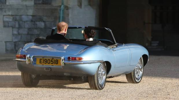 The newly married Duke and Duchess of Sussex leave Windsor Castle in a convertible Jaguar E-Type after their wedding to ...