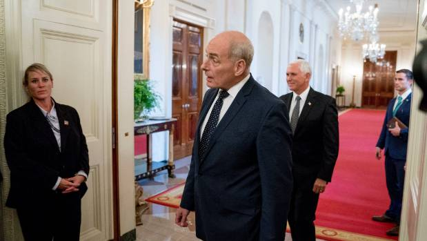 """President Donald Trump's chief of staff John Kelly, centre, reportedly called Trump """"an idiot""""."""