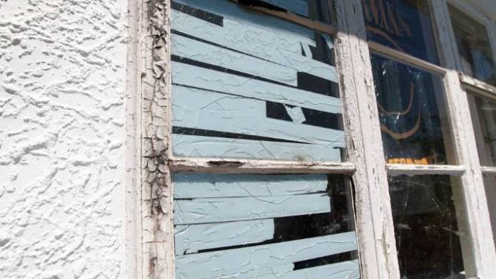 Glued windows in the house after being blown up by the heat of the fire.