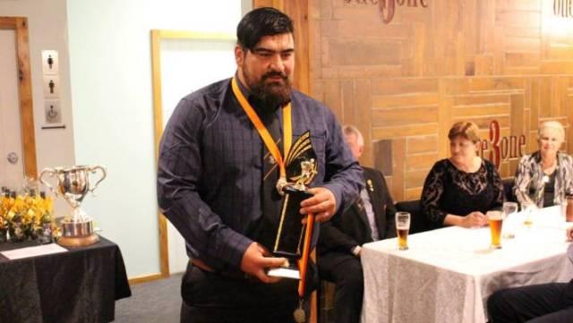 Sergio de la Fuente accepts an award for most improved.