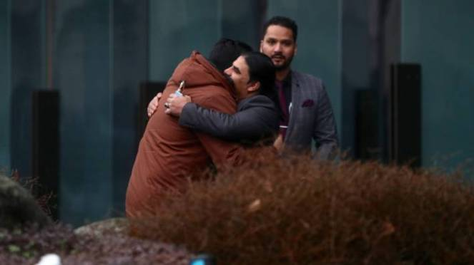 Linwood mosque hero Abdul Aziz hugs a friend outside the Christchurch court house.
