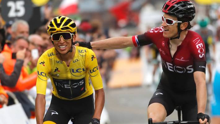 Geraint Thomas, right, congratulates team-mate Egan Bernal as they cross the finish line of the 20th stage.