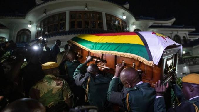 Zimbabwe's founding leader Robert Mugabe made his final journey back to the country Wednesday, his body flown into the capital amid the contradictions of his long, controversial rule.
