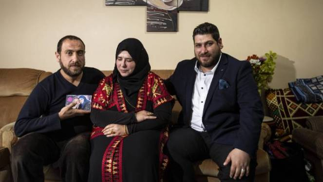 Manal Dokhan relies on the support of her brothers, Saqr, left, and Bader, right, after she had two heart attacks when her husband Mohsin Al-Harbi was killed in the Christchurch terror attack.
