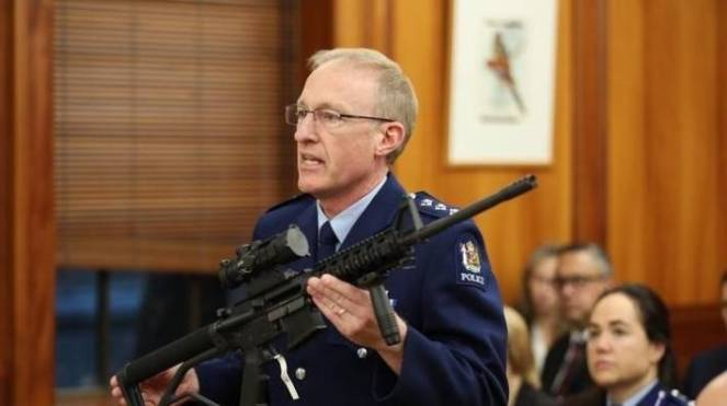 Police inspector Mike McIlraith displays an AR-15 during the select committee stage of the Arms (Prohibited Firearms, Magazines and Parts) Amendment Bill, similar to the one used on March 15.