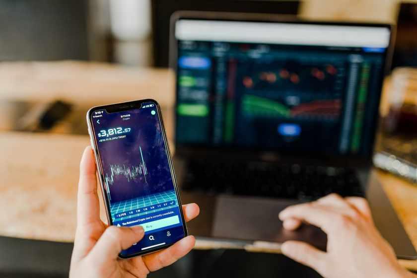 stock-market-robo-advisor-phone-with-mac-laptop-velox-clearing