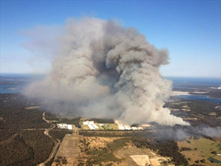 NSW bushfire reached 'doorsteps' of homes.