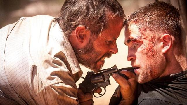 """Stoically grizzled"" ... Guy Pearce and Robert Pattison have received rave reviews at the"