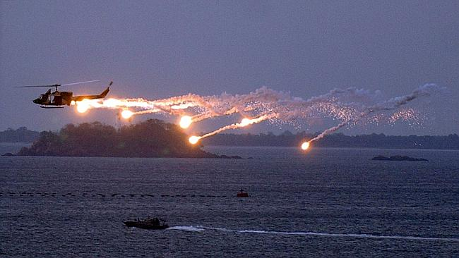 A Sri Lankan military helicopter releases flares over the naval base in Trincomalee.