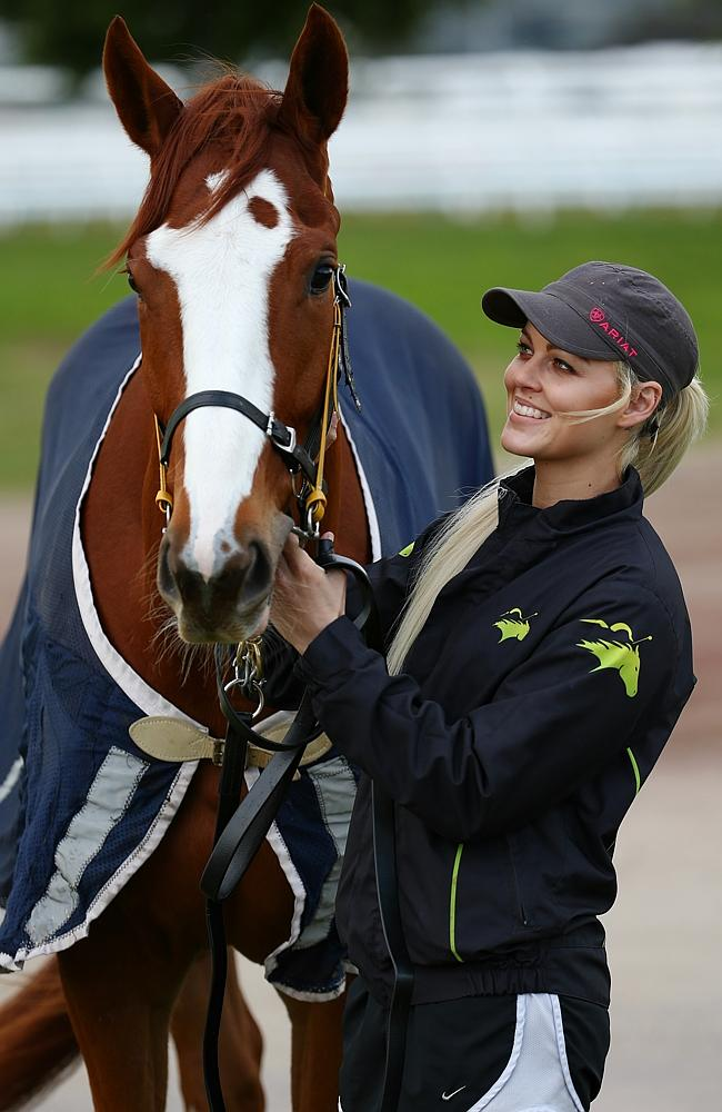 Looks Like The Cat with his handler Kiaarn Holland at Flemington. Picture: Michael Klein