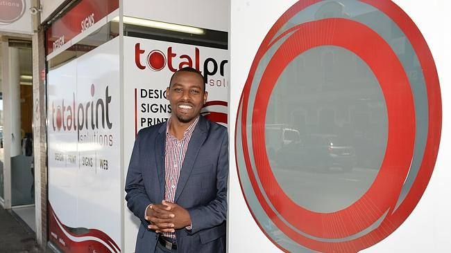 Gemeda Adem outside his business Total Print Solutions.