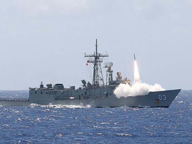 Guided missile frigate ... Missile firing from HMAS Sydney, which is heading to intercept
