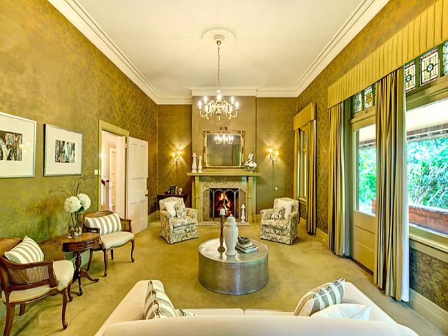 The house has elegant formal living and dining areas.