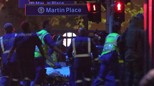 Armed tactical response officers and emergency workers attend the scene (AP Photo/Rob Gri