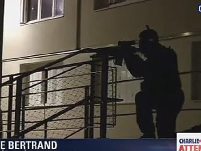 Police surround a property in Reims where it is believed they have the terrorists cornere