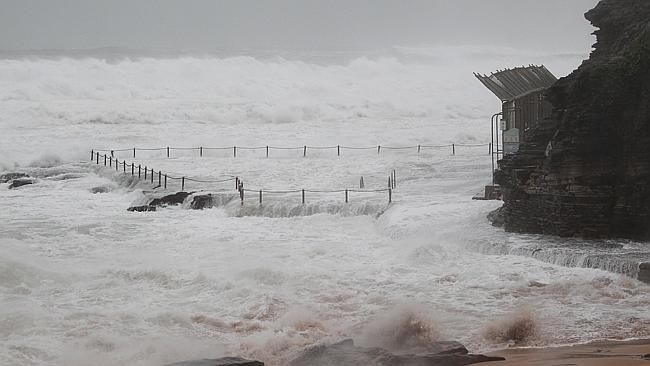 Avalon pool virtually disappeared in big seas. Picture: Martin Lange