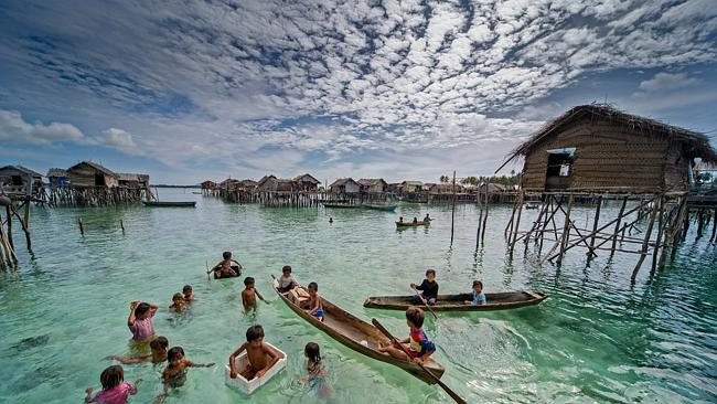 The Bajau people of Malaysia live almost entirely at sea, living in wooden huts on stilts