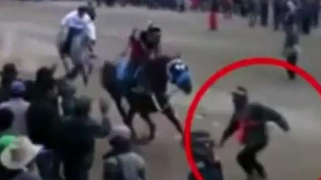 Shocking footage ... horse racing fan Faustino Landeo Delgadillo was killed after running