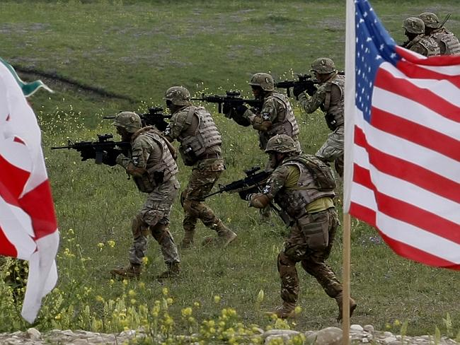 Sending a message . US and Georgian servicemen take part in ajoint exercise outside the G