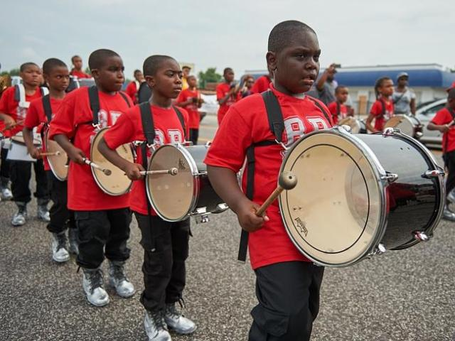March for change ... Children play as a part of a marching band during a rally in Ferguso