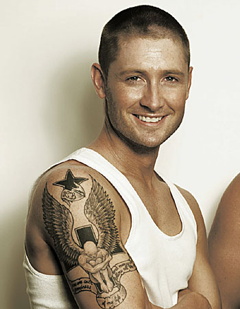 Michael Clarke's tattoo of a giant guardian angel, sittign on a cross with