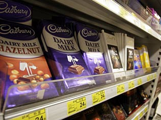 Cadbury's owners Mondelez International defend decision to reduce the weight of the chocolate block