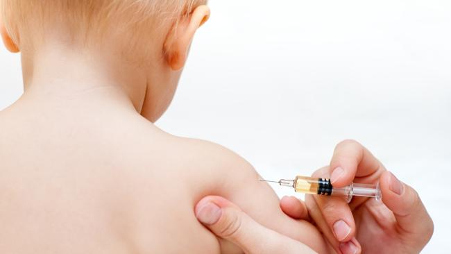 A baby gets an injection. Vaccination. Child. Syringe. Generic image.