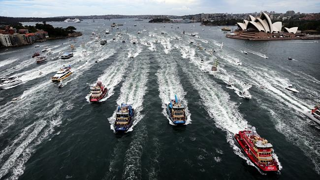 Sydney Harbour turns into a race course as the iconic Sydney Ferries head for the Harbour Bridge.