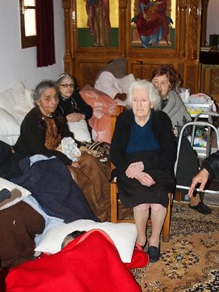 Shelter ... women gather inside a church in Kefalonia after last week's ear...