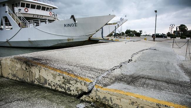Cracked ... damage is visible at a port in Kefalonia after last week'...