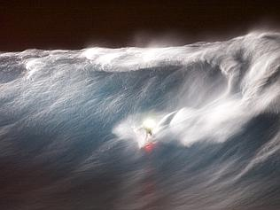 Big wave surfer Mark Visser makes history in Maui with a night ride on waves measuring 10