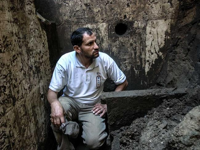 Out of the past ... An archaeologist sits amid the motifs — and muck — filling the memori