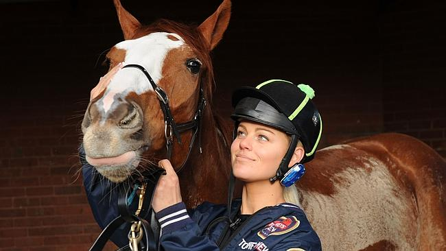 Kiaarn Holland with Looks Like The Cat after riding him at a trackwork session at Fleming