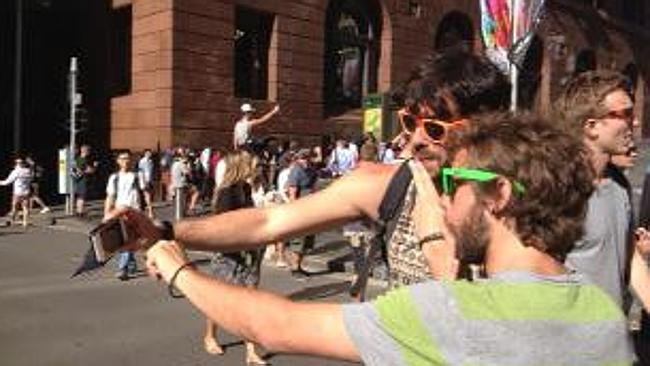 Go home...Two men take a selfie in the street while watching events. Photo: Supplied.