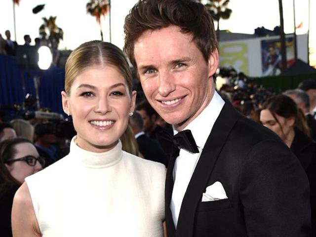 Rosamund Pike (L) and Eddie Redmayne attend the 20th annual Critics' Choice Movie Awards.