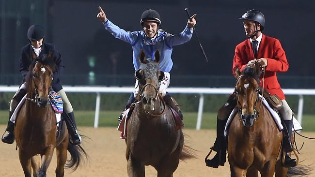 William Buick celebrates his amazing win on Prince Bishop in Dubai.