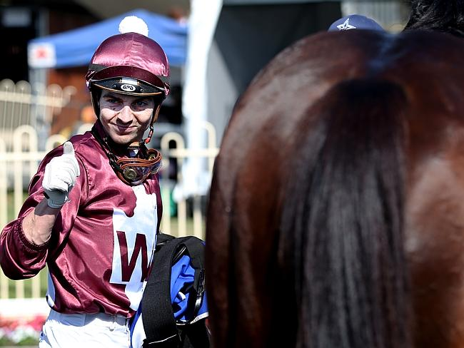 Ric McMahon gives Doomben winner Whittington the thumbs up in late May.