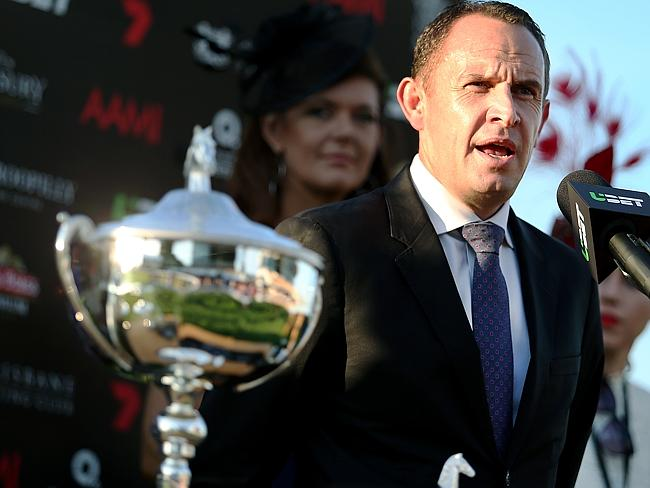 Winx: Chris Waller and Queensland Oaks trophy in the foreground.