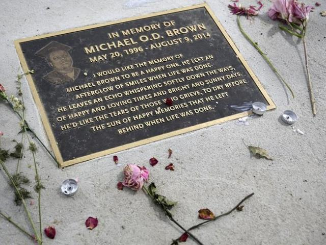 Touching tribute ... A plaque in memory of Michael Brown is seen in a sidewalk near where