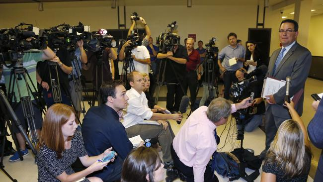 Prosecutor Jason Hicks, right, talks to the media following the teenagers' court appearance. Picture: AP