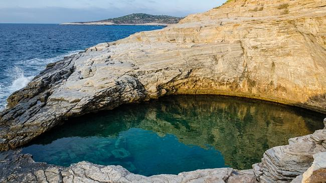 Taking infinity pool to another level, this lagoon opens up to the Aegean Sea.