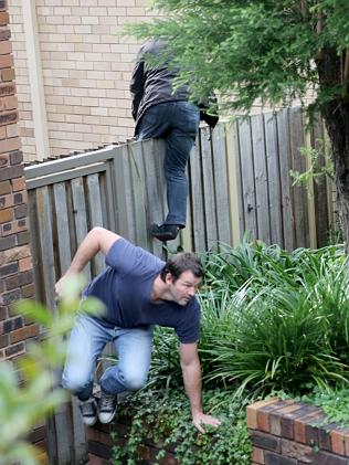 Detectives storm Rogerson's property this morning.