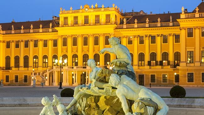 The illuminated Schonbrunn Palace, Vienna, at dusk.